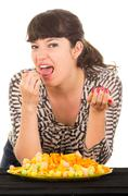 young girl overeating junk food - stock photo
