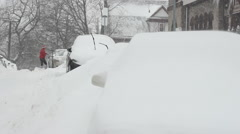 LS person cleaning snow off car Stock Footage