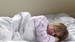 Woman waking up in bed Stock Footage