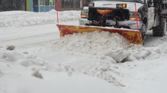 Snow plow pushing snow into a pile - stock footage