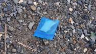 Stock Video Footage of drugs in plastic bag on ground
