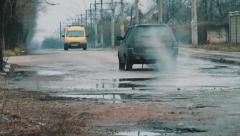 Cars go on the broken road - stock footage