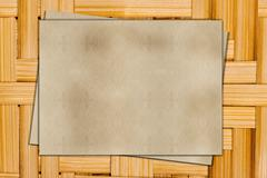 Old ragged paper on a wooden background Stock Photos