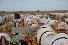 DADAAB, SOMALIA-AUGUST 07: Unidentified men, women & children wa - stock photo
