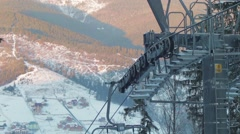 Ski lift in the work with mountain views Stock Footage