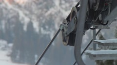 Ski lift in the work with mountain views. Close up Stock Footage