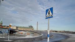 Stockholm slussen female road sign pan to road bridge Stock Footage