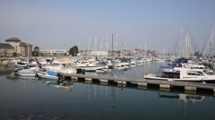 Weymouth marina Dorset UK boats and yachts with blue sky - stock footage