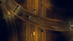 Aerial, vertical - Traffic at night. Roundabout over highway - stock footage