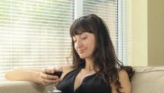 woman drinking red wine alone - stock footage