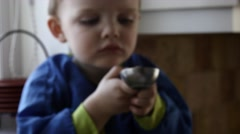 A little boy eating ice cream in his house Stock Footage