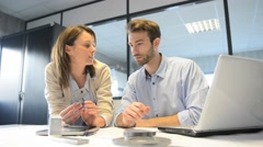 Engineers in industrial sector working in office - stock footage