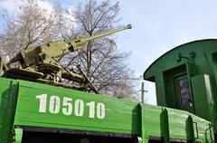 Anti-aircraft gun on a railway platform - stock photo