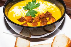 Vegetarian Pumpkin Soup With Grated Cheese - stock photo