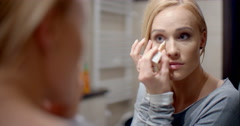 Pretty Blond Woman Applying Eyebrow Makeup Stock Footage