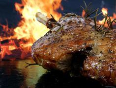 Traditional English wine marinade roast by romantic fire Stock Photos