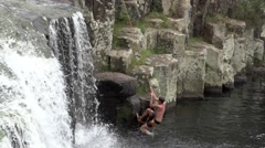 Man climbing on Charlies Rock waterfall kerikeri Northland New Zealand 03 Stock Footage