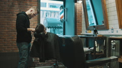 Barber shave the beard of the client with trimmer Stock Footage