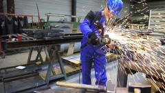 Man in workshop manufacturing metal - stock footage