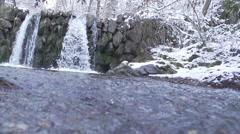 Winter landscape in the mountains with snow and waterfall in slow motion Stock Footage