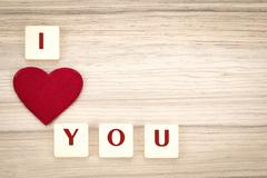 valentine's hearts on a wooden background and tex i love you - stock photo