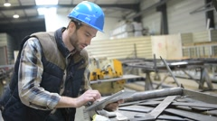 Engineer in metallurgical factory using tablet Stock Footage