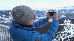 Young woman uses a smartphone to video a beautiful view HD Stock Footage