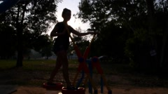 Young Sporty Woman Taking Exercises at Sunset Stock Footage