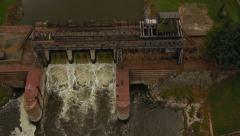 Aerial of soldier military personnel dam lift up to high wide angle shot Stock Footage