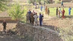 Crowd of Afghan Muslims gathering, Afghanistan - stock footage