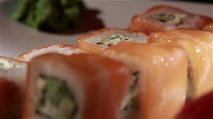 Delicious sushi on white plate, close up, dynamic change of focus Stock Footage