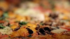 Dynamic change of focus, pizza with tomatoes, cheese and peppers, close up Stock Footage