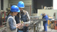 Industrial people meeting together in factory - stock footage
