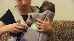 Baby In His Carrier Stock Footage
