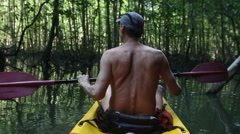 elder tanned man floating on kayak - stock footage