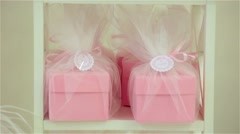 Bright, festive, pink gift, present boxes and cakes above Stock Footage