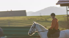 Person enjoying riding horse at sunset Stock Footage