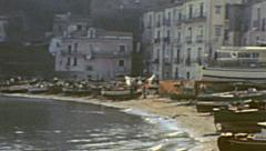 Capri 1962: small boats parked in the beach Stock Footage