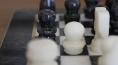 Dolly shot of marble chess pieces on chess board Stock Footage