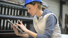 Engineer in metallurgical factory using tablet Stock Footage