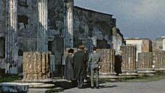 Pompei  1962: tourists visiting Roman ruins - stock footage