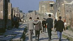 Pompei  1962: visitors walking on Roman Ruins - stock footage
