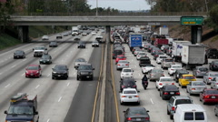 Zoom Out / Overhead View of Traffic on Busy Freeway in Downtown Los Angeles - stock footage