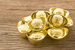Chinese new year ornament--Stack of chinese gold ingots - stock photo