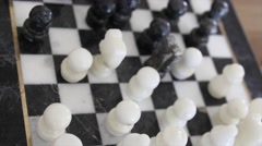 Shot of chess pieces on the stone chess board Stock Footage