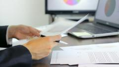 Working with documents at the office Stock Footage