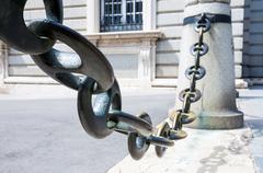 Massive metal chain on sidewalk in Madrid - stock photo