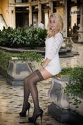 Elegant pretty blonde young woman in posh city setting in Europe Stock Photos