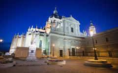 Pope John Paul II statue in front of Cathedral Almudena Stock Photos