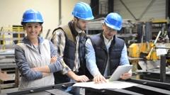 Industrial engineers meeting in mechanical factory - stock footage